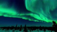 Time lapse of Aurora Borealis over Arctic tundra.