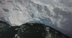 Aerial view of ice carving from glacier in Antarctica