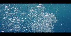 Scuba Diver air bubbles rising to the ocean surface