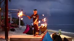 Local man fire dancing on the beach