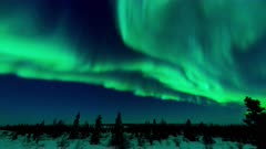 Time lapse of Aurora Borealis over Arctic tundra.