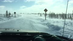 Driving in a car during storm on the Tundra in Canada