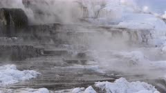 Mammoth Hotsprings in Yellowstone N.P., steaming in winter.