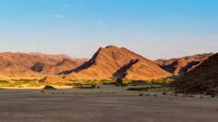Time lapse of sunset on mountains in the Hoanib desert, Namibia