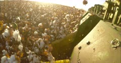 Cotton picker working in a cotton field during sunset