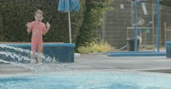 Little girl swimming and diving in a swimming pool