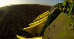 POV shot from a large cotton picker in a cotton field
