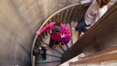 People Walking Down Spiral Staircase