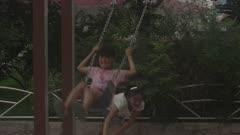 Kids Playing on the Swing Set