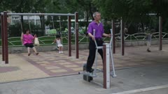 Man exercising in city park
