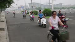 People Riding bikes and motorized scooters