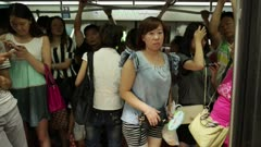 People hop on crowded train