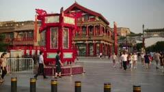 People walk through qianmen street