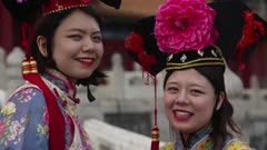 Two woman dressed up as empresses in the Forbidden City