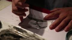 Artist creates ink wash painting