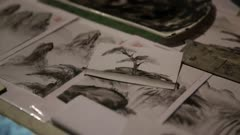 Ink wash painting spread across table