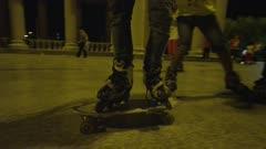 Man Riding skateboard while wearing rollerblades