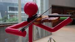 Red Stick Figure holds violin
