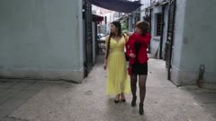Two Woman Walk down sidewalk