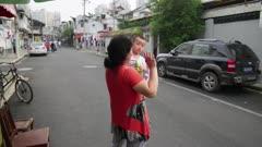 Woman and Baby wave at camera