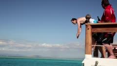 Man dives into ocean