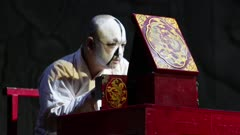 Performer paints face in prep for Beijing opera performance