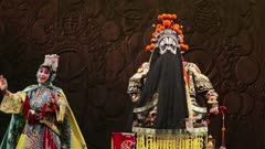 Man & Woman perform in Beijing Opera with ensemble