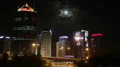 Moon shines over Beijing Skyline