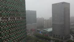 Overcast clouds & fog pass over Zizhu Building