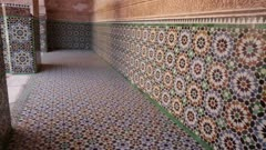 Patterned walls and floor in Ben Yousseff Medersa courtyard - Handheld