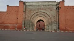 Traffic passes in front of Bab Agnaou gate - Static