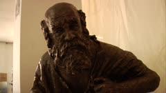 Bronze statue of a beggar