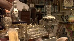 Silver antiques displayed in small store