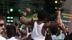 kid waving his arms at concert