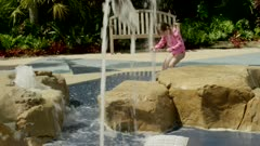 Little kids playing with water