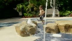 Little boy running through water