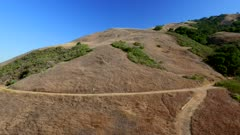 Aerial over hills and ocean in Big Sur