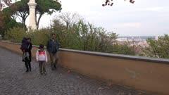 People walk down path