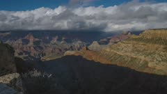 Time lapse of a rainstorm and rainbow passing over the Grand Canyon's South Rim during the winter