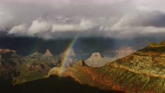 Stormy weather and double rainbows near South Rim entrance of the Grand Canyon