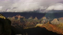 Stormy weather and rainbow near South Rim entrance of the Grand Canyon