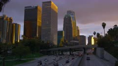 Downtown Los Angeles at sunset with traffic