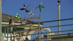 Pinwheels spinning in the breeze at Huntington Beach Pier, California