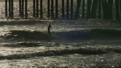 Surfers at Huntington Beach Pier, California