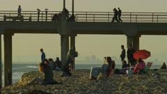 People at the beach at Huntington Beach Pier, California