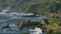 Scenic view of ocean waves crashing on the California coast by Bixby Bridge in Big Sur