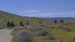 Horseback riders at Antelope Valley California Poppy Reserve near Lancaster, California
