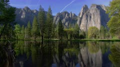 Reflection of Cathedral Rock and surrounding forest in a river