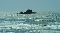 Waves crashing on rocks in ocean