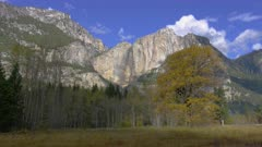Yosemite Falls and Yosemite Point surrounded by trees with fall colors